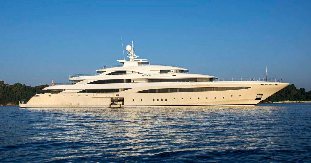 motor yacht O'PTASIA anchors on a luxury yacht charter