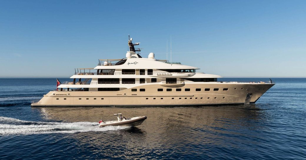 superyacht 'Here Comes The Sun' cruises alongside tender on a luxury yacht charter