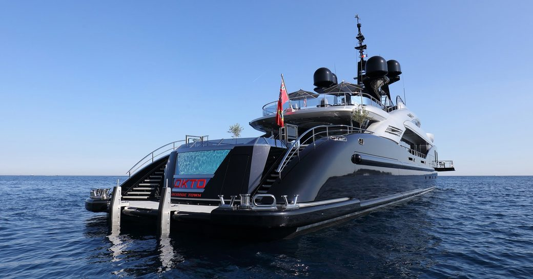 aft view of superyacht OKTO with infinity swimming pool