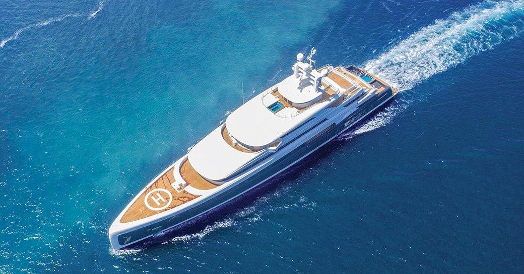 superyacht Illusion Plus underway on her maiden voyage