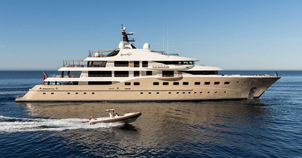 motor yacht Here Comes The Sun cruising alongside tender on a luxury yacht charter