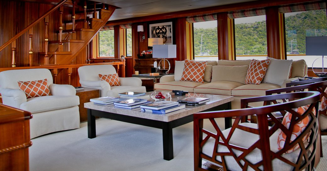 plush cream sofas and armchairs in the main salon aboard motor yacht M4