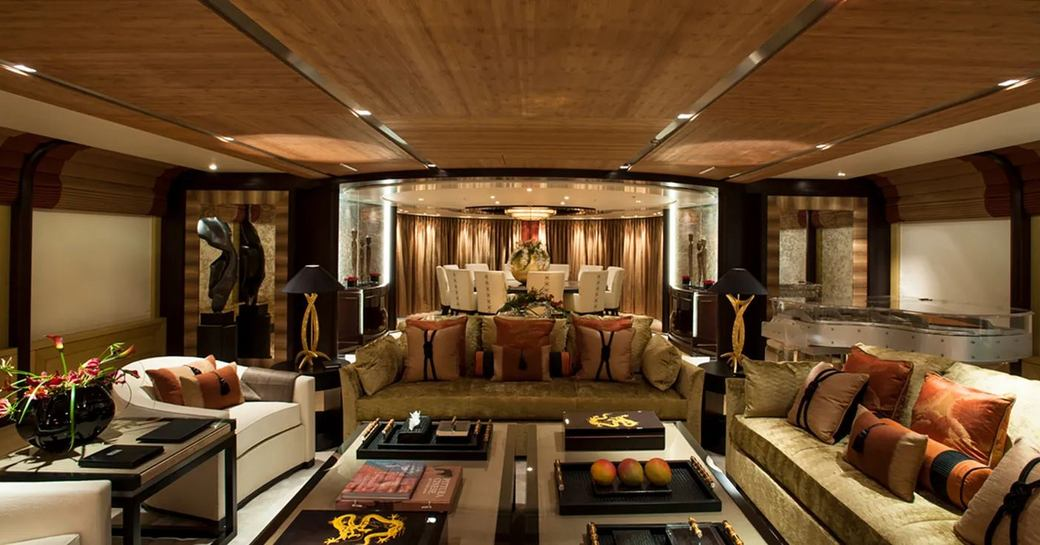 Elegant interior with sofas and chairs in superyacht Sea Rhapsody
