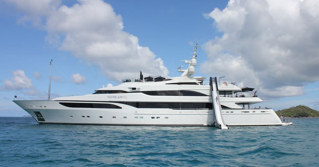 motor yacht silver angel docked with inflatable water slide