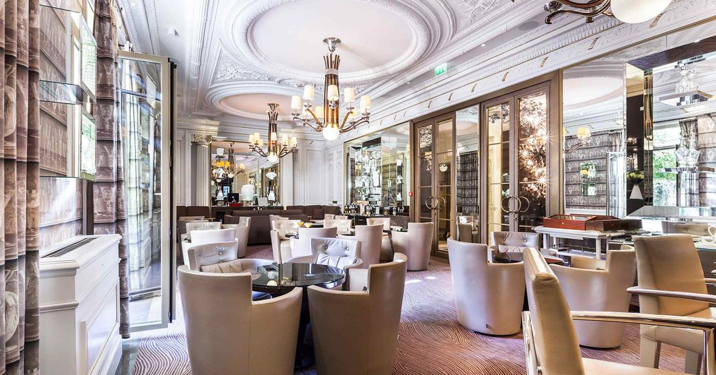 interiors of crystal bar in monaco, with chandeliers and plush seating