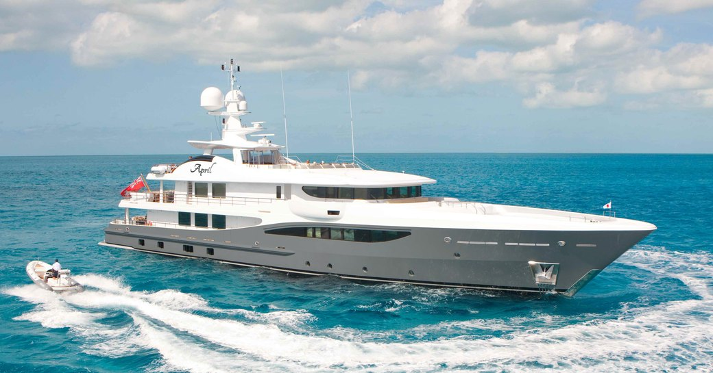 Superyacht LIND underway, being circled by tender, surrounded by sea