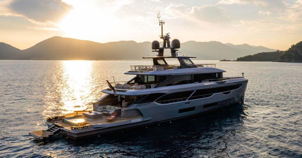 Benetti superyacht REBECA on water at sunset