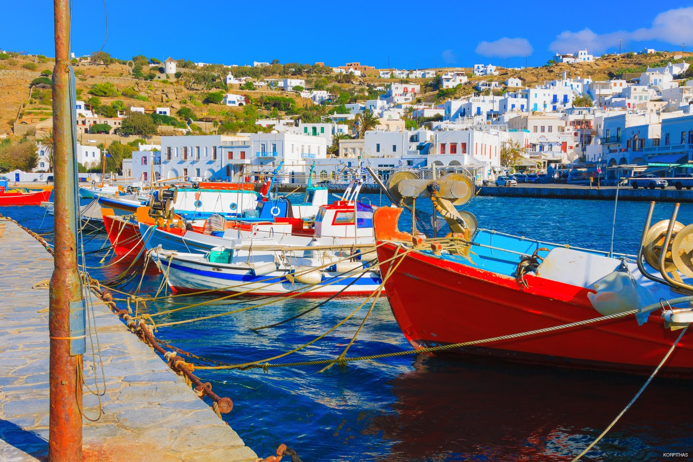 See the famous Mykonos Windmills in Greece while eating at a local restaurant