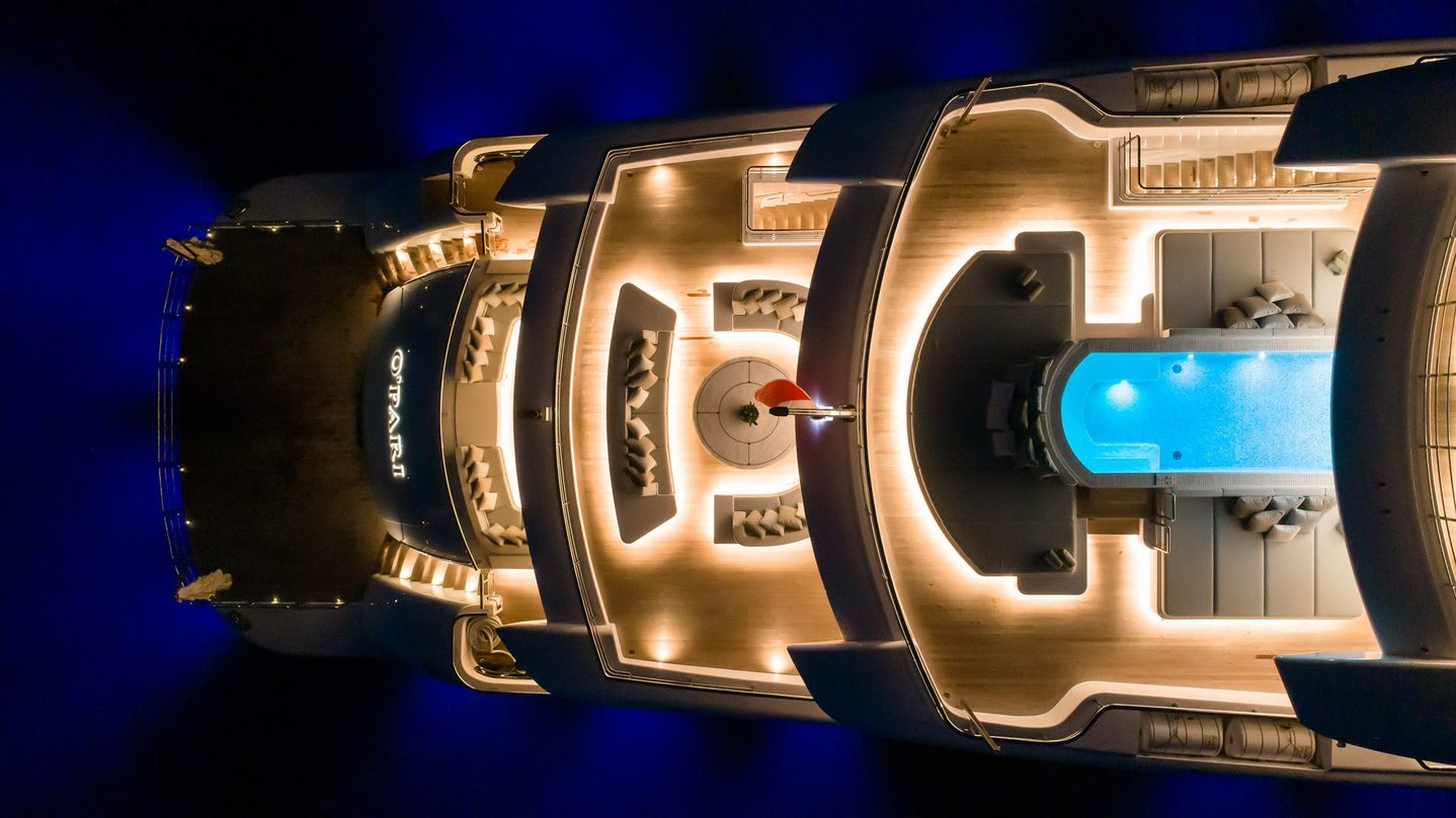 Superyacht O'PARI viewed from above, decks lit up at night