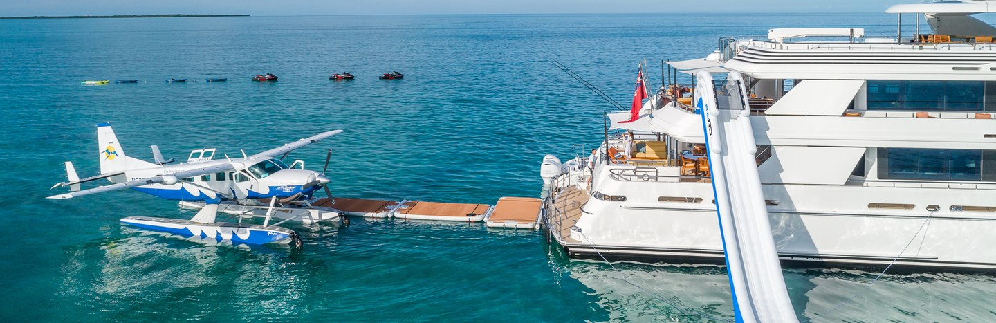 Private seaplane next to superyacht in Bahamas