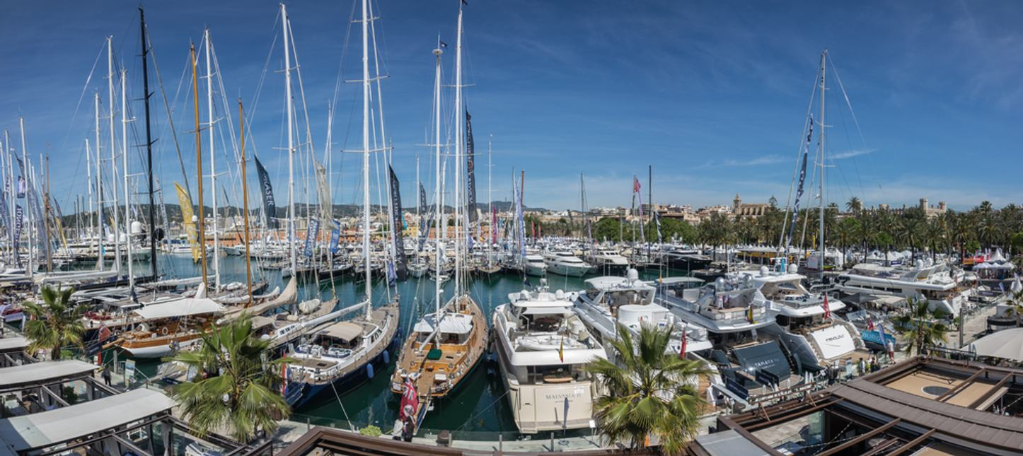 Luxury yachts line up in the port for the Palma Superyacht Show