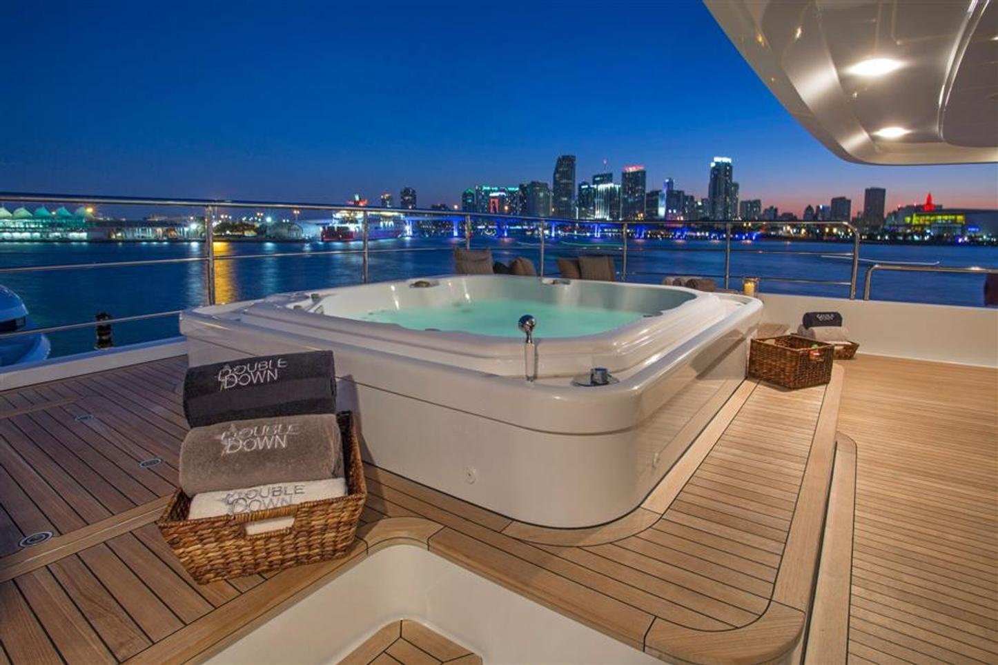 The Jacuzzi lit up on board superyacht Double Down at night