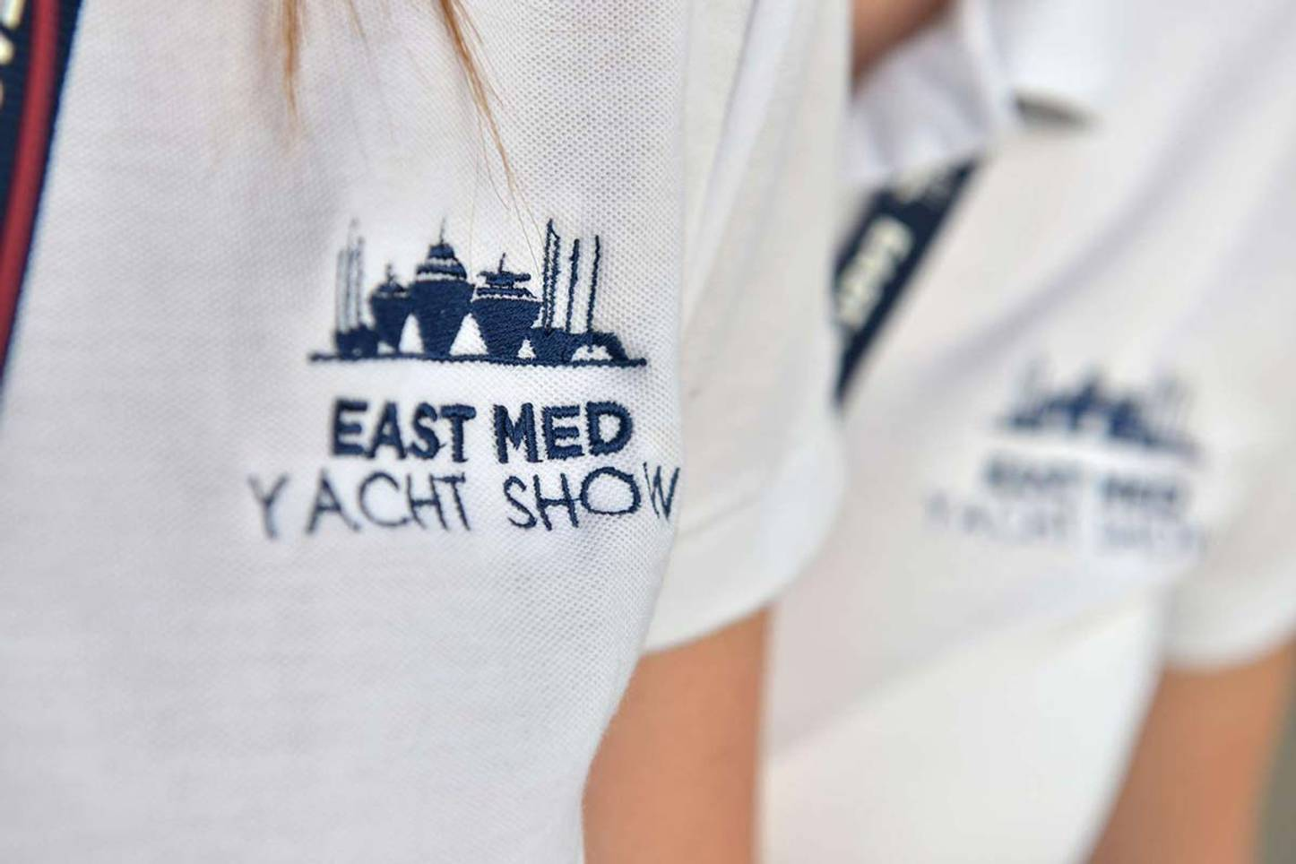 Show organiser wears a t-shirt with 'East Med Yacht Show' motif