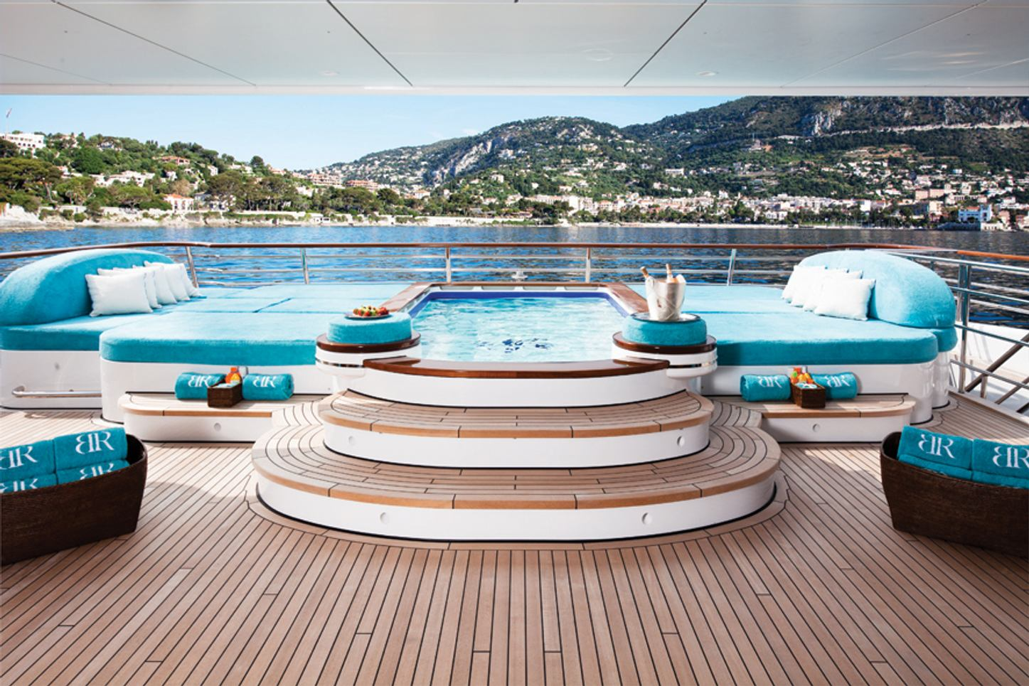 pool surrounded by sunpads on board superyacht Baton Rouge
