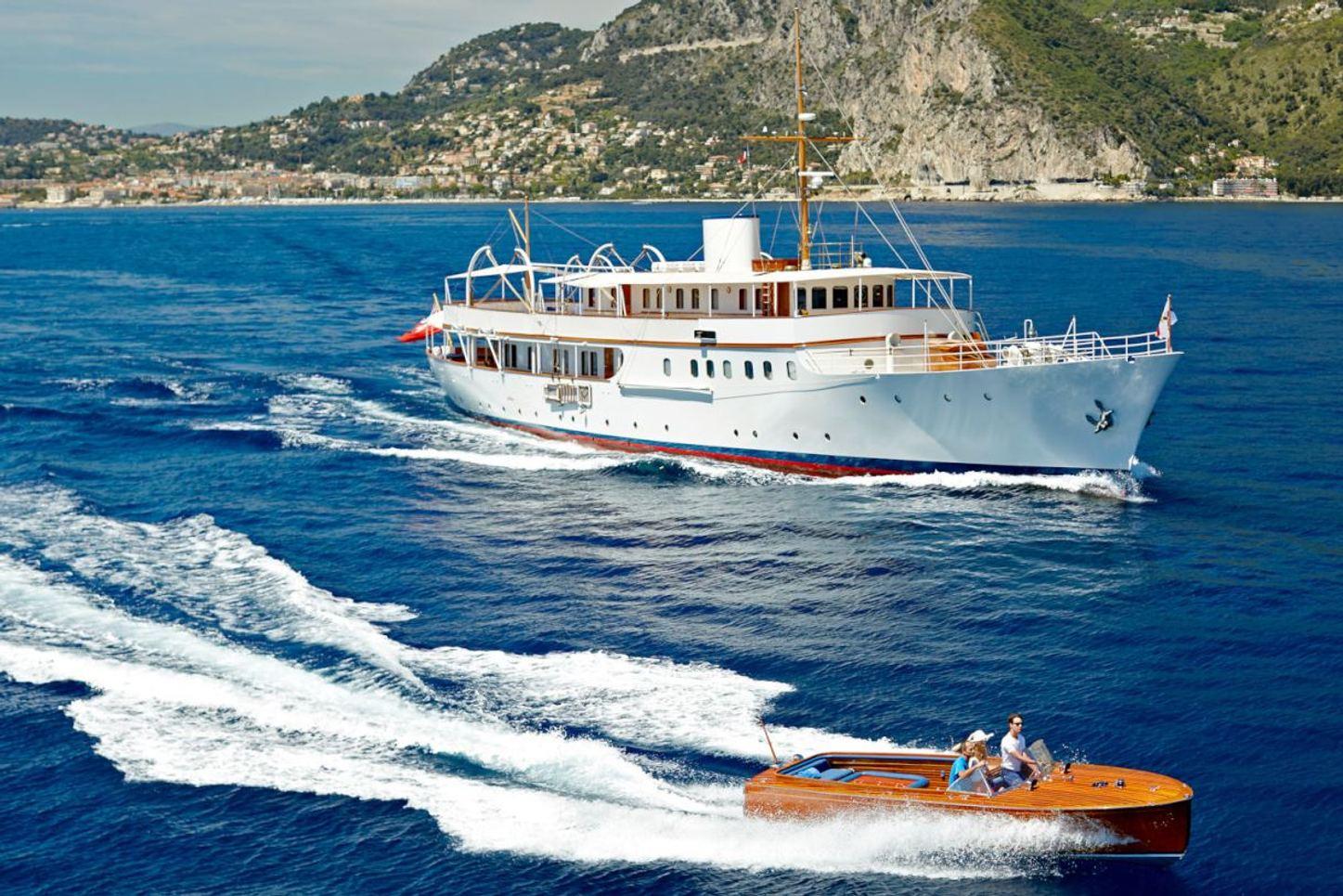 Luxury yacht Malahne in the Mediterranean next to tender
