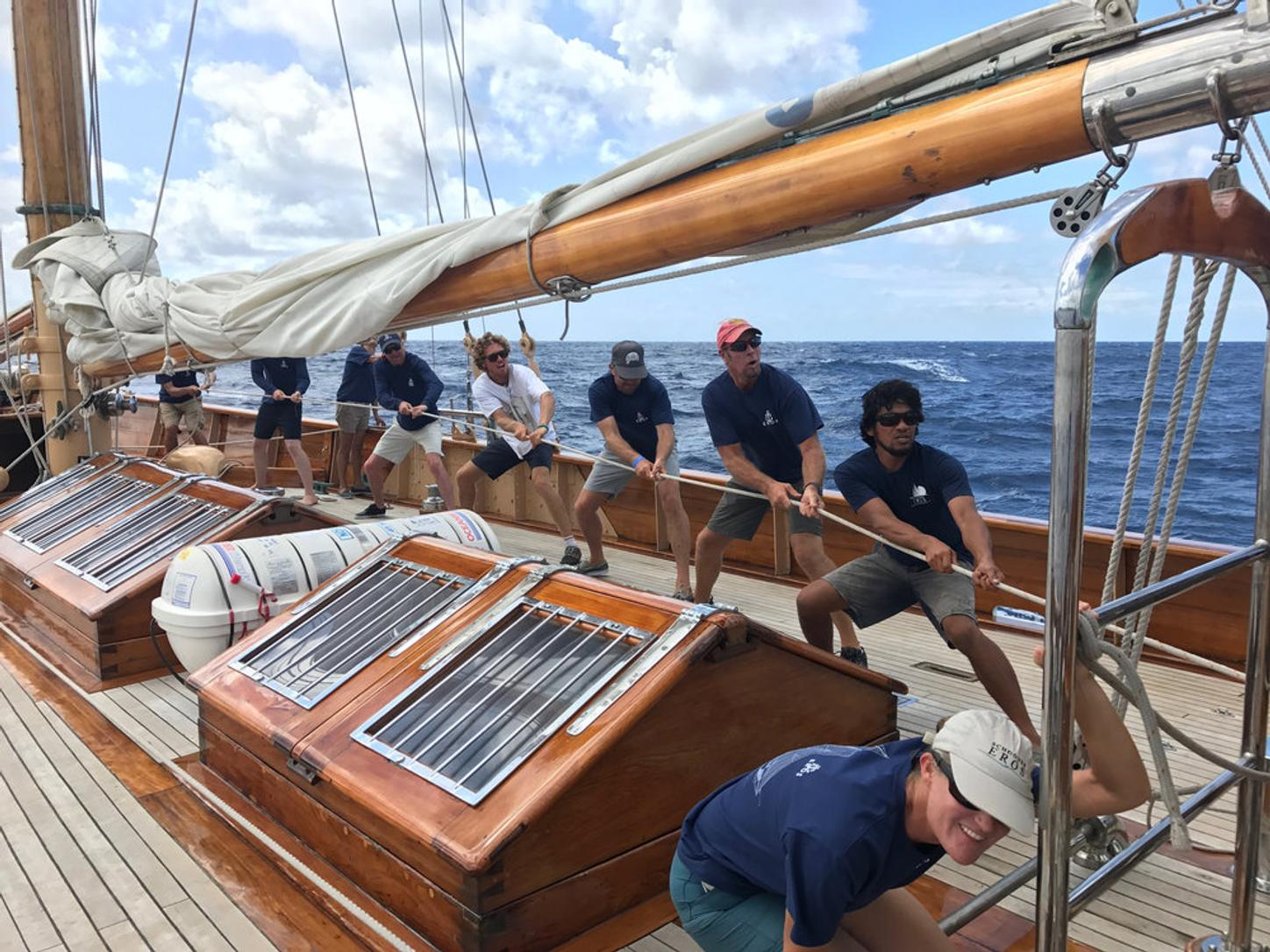 sailors group together during a regatta charter on board sailing yacht EROS