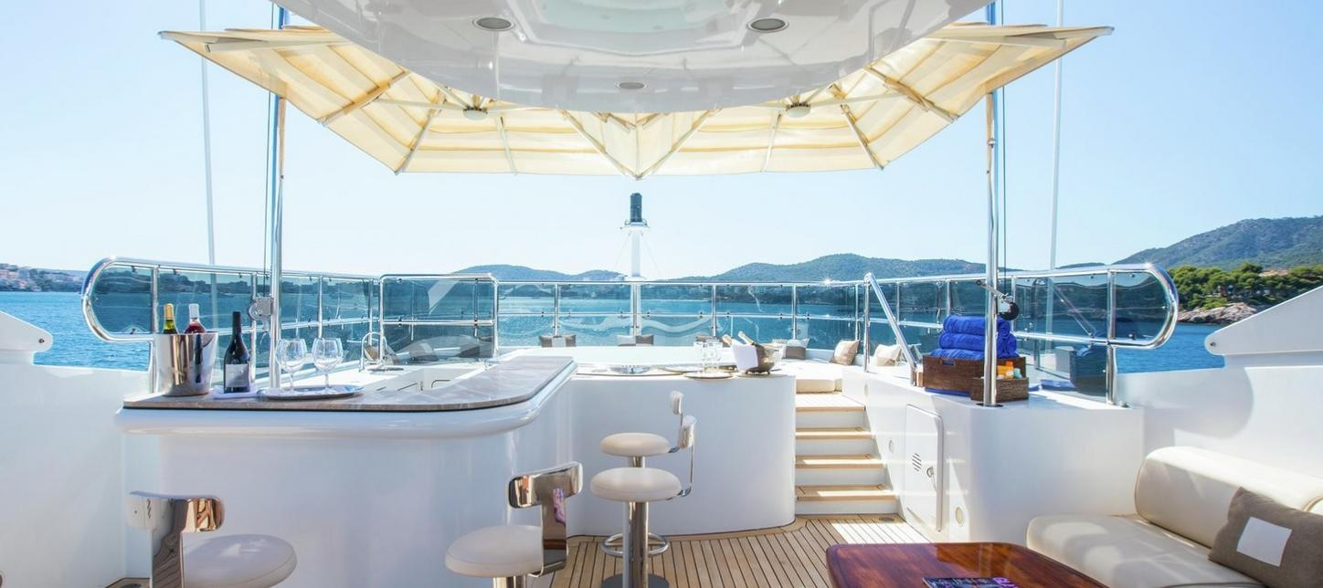 Bar and step-up Jacuzzi on board charter yacht DIANE