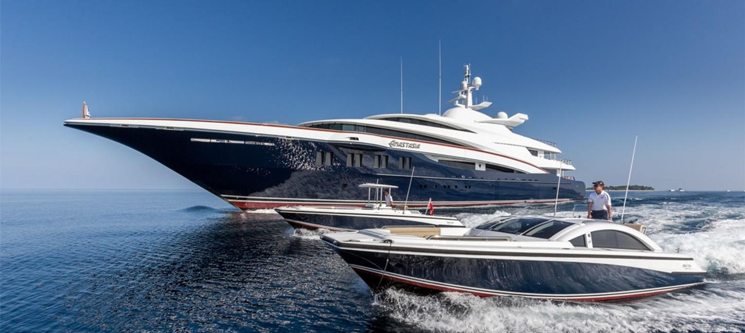 motor yacht WHEELS cruises on a Mediterranean yacht charter alongside custom tender