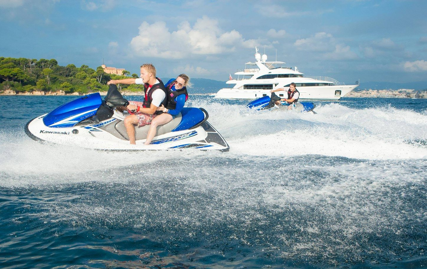 Charter guests playing with toys on superyacht DYNAR