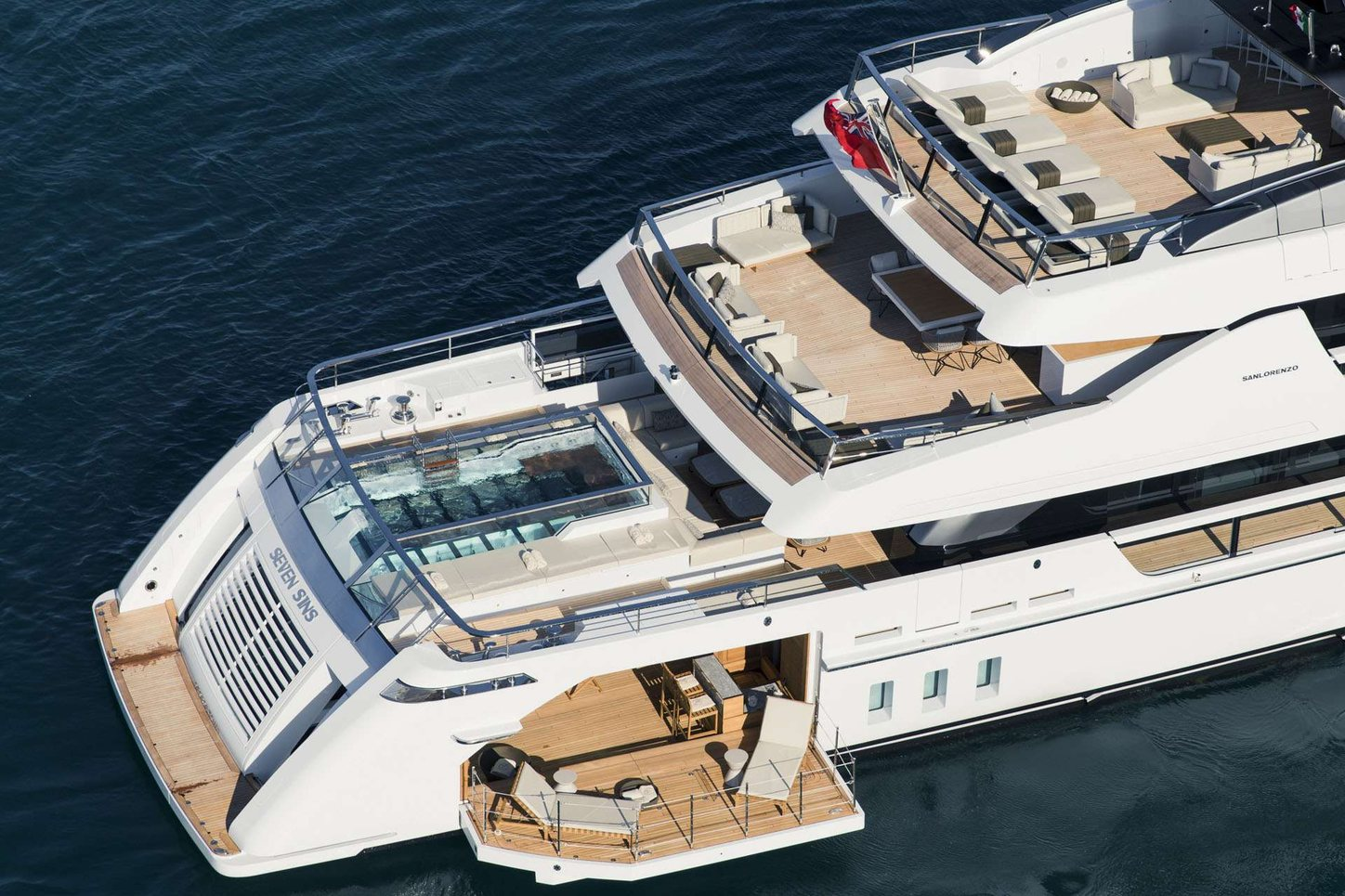 A graphic rendering which shows the beach club folding out from the aft of superyacht Seven Sins