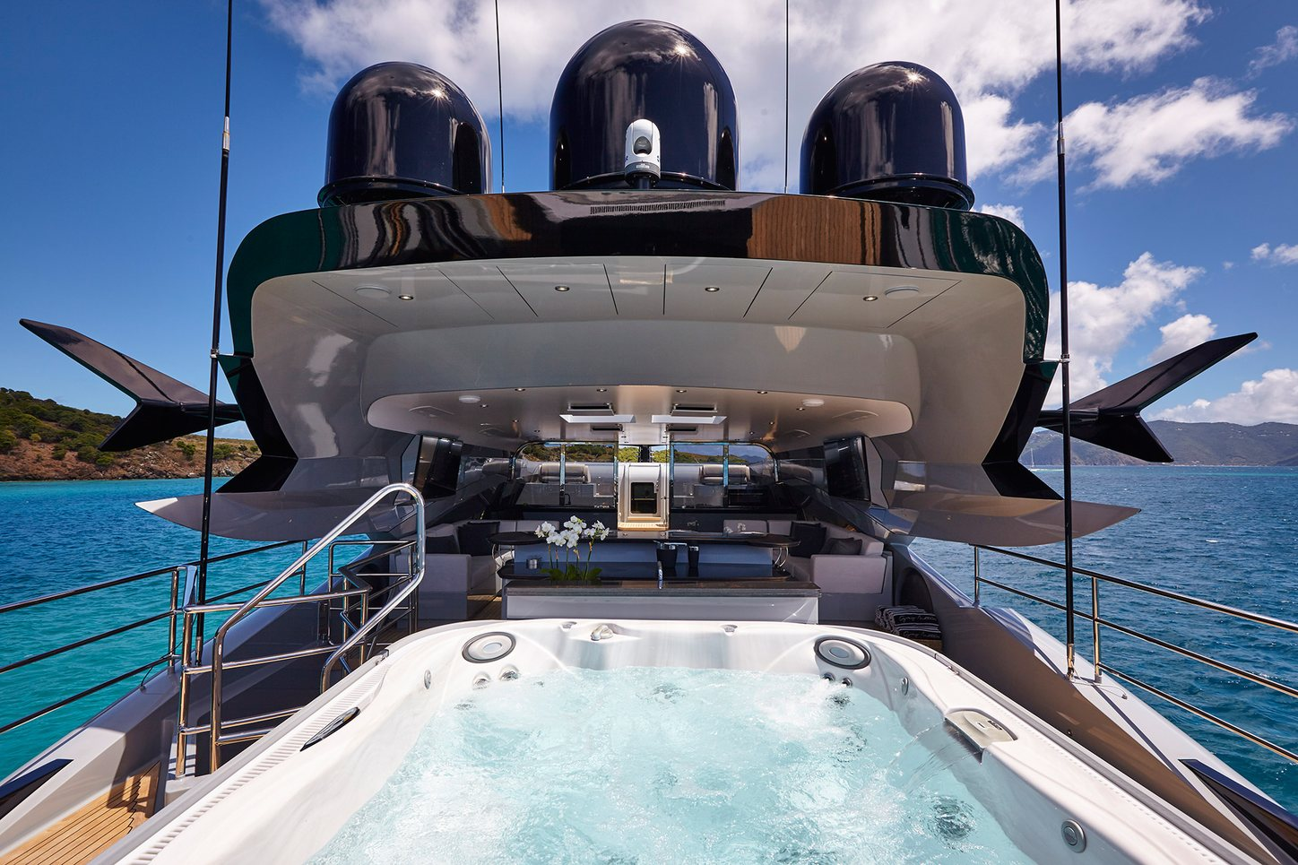 pool on sundeck in foreground of luxury yacht grey matters