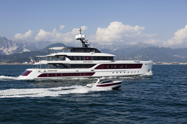 motor yacht Quinta Essentia cruises alongside its custom-made, matching tender on a Mediterranean yacht charter