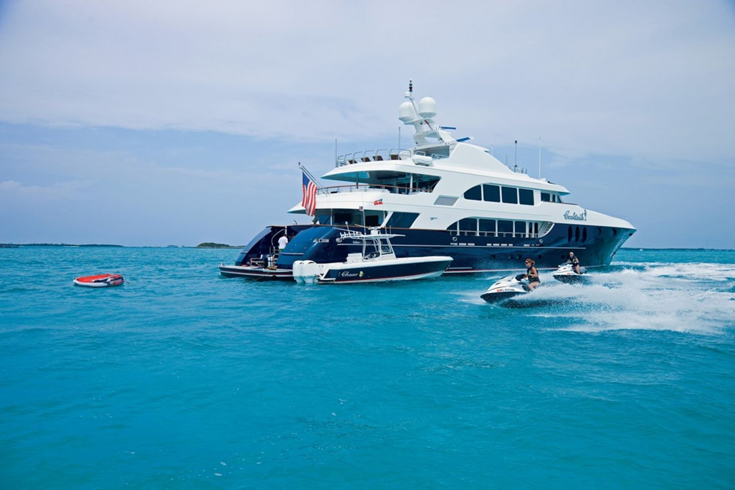 luxury motor yacht for charter alessandra, from trinity yachts, on the water showing off aft decks, with tenders in the water surrounding