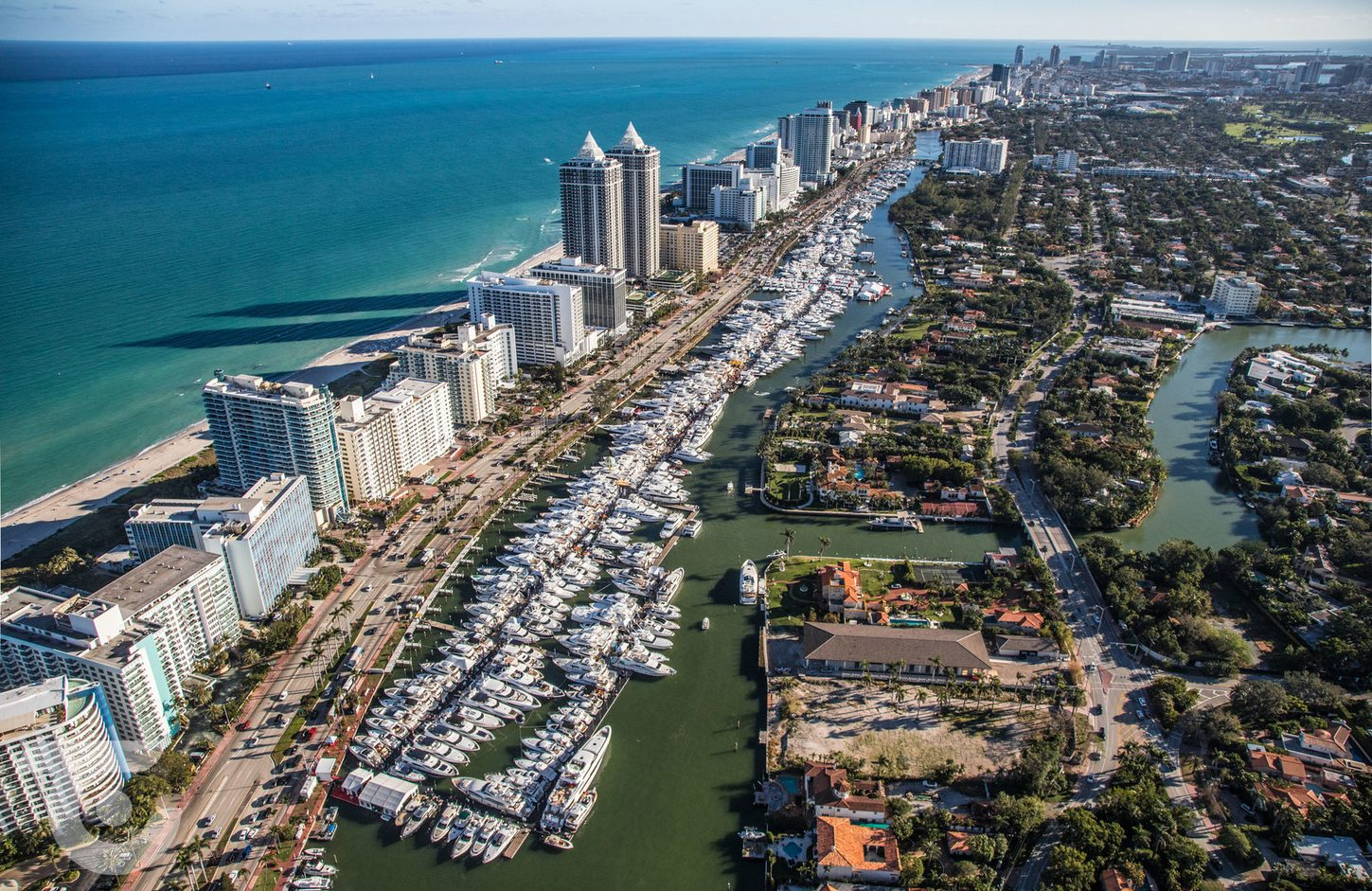 yachts lined up along the Indian Creek Waterway for the Miami Yacht Show