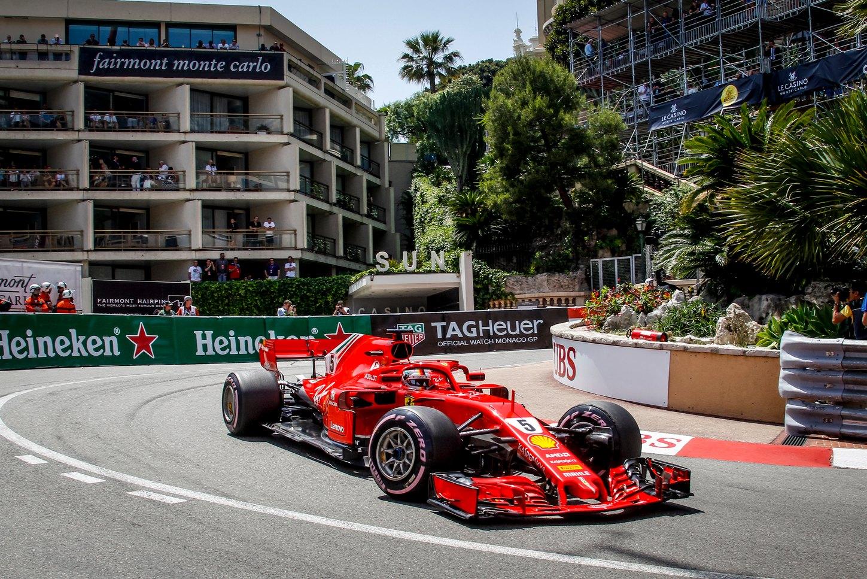 Cars speeding around the track at the f1 Monaco Grand Prix