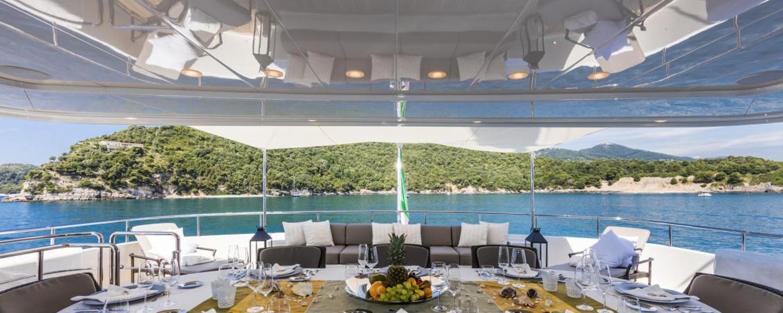 AL fresco dining area on motor yacht for charter Ferdy