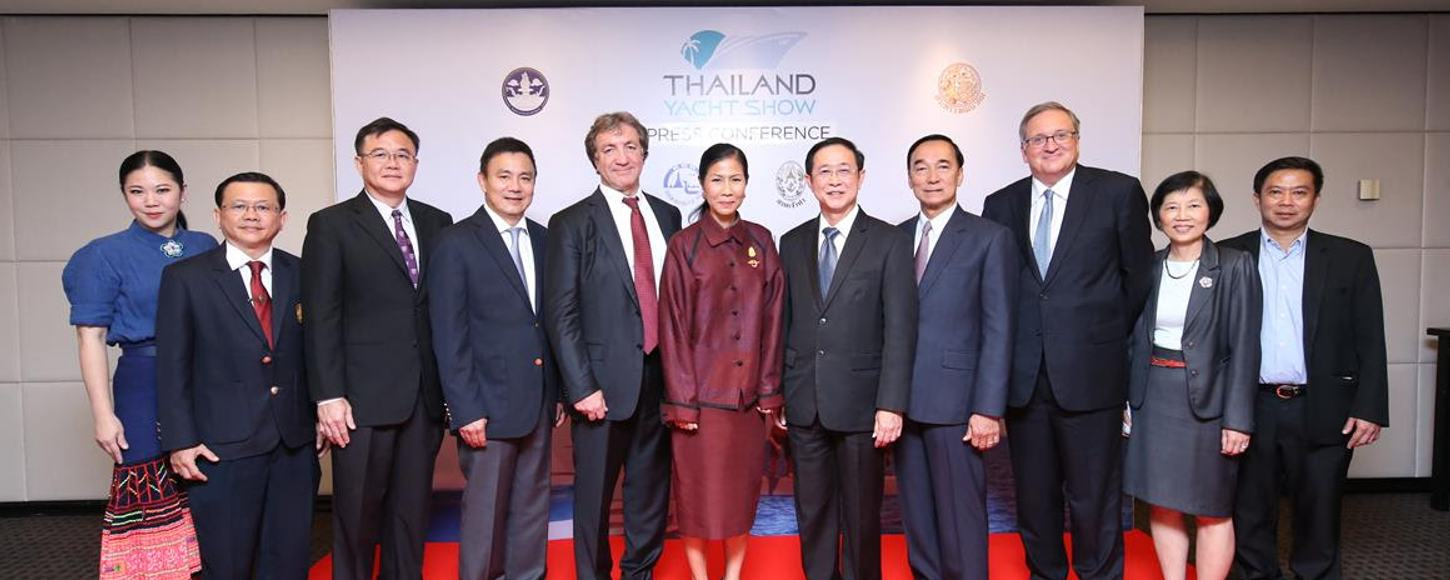 Thai government official posing at a press conference for the 2016 Thailand Yacht Show