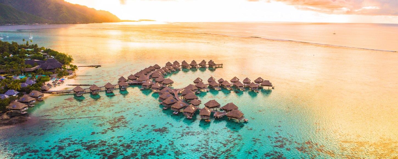 Overwater bungalows in Tahiti at sunset