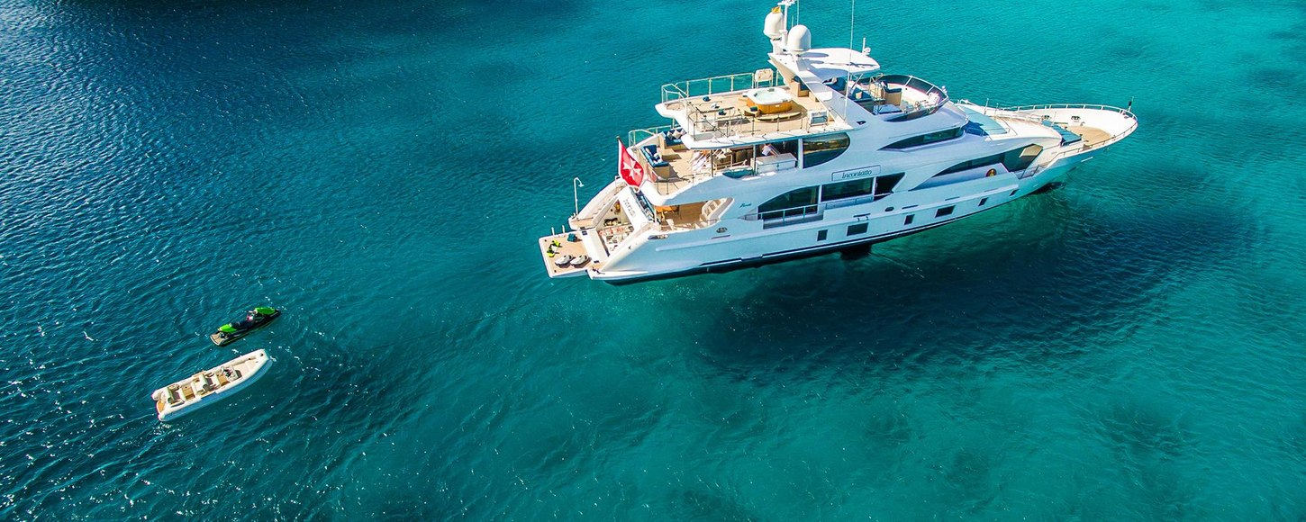 Luxury yacht LULU at anchor surrounded by toys