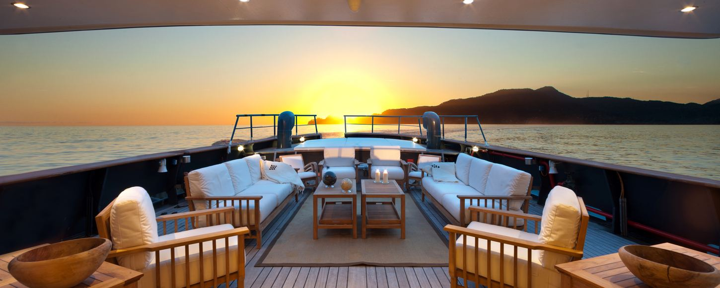 Main deck seating area at sunset on board superyacht Vervece