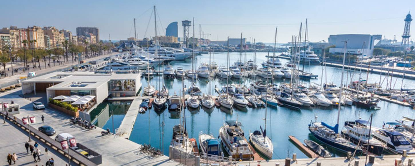 Superyachts docked in the OneOcean Port Vell in Barcelona