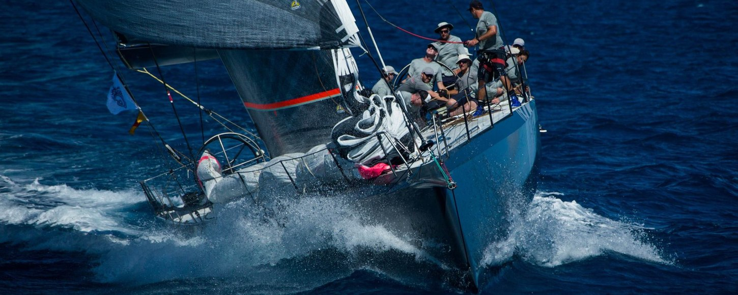 yacht cuts through the water at the RORC Caribbean 600