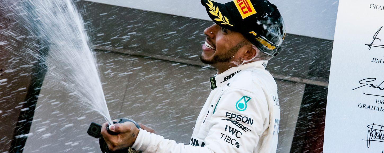 Lewis Hamilton celebrating winning F1 Grand Prix