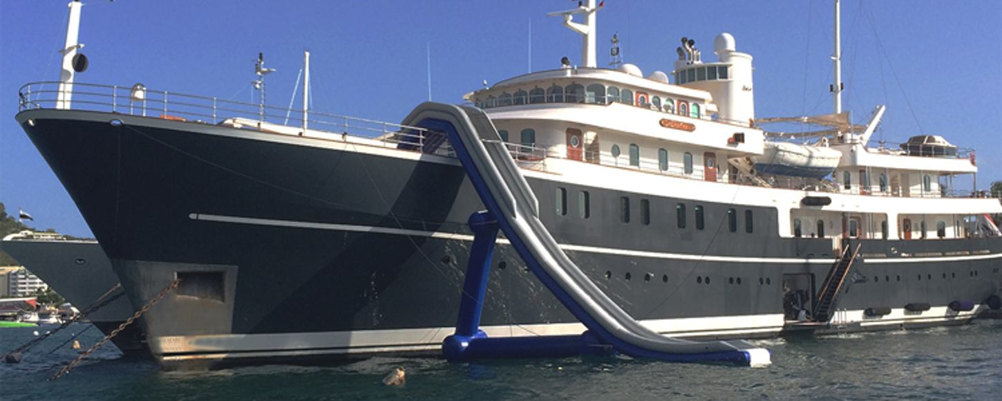 Superyacht Sherakhan at anchor on charter in Mediterranean with water slide