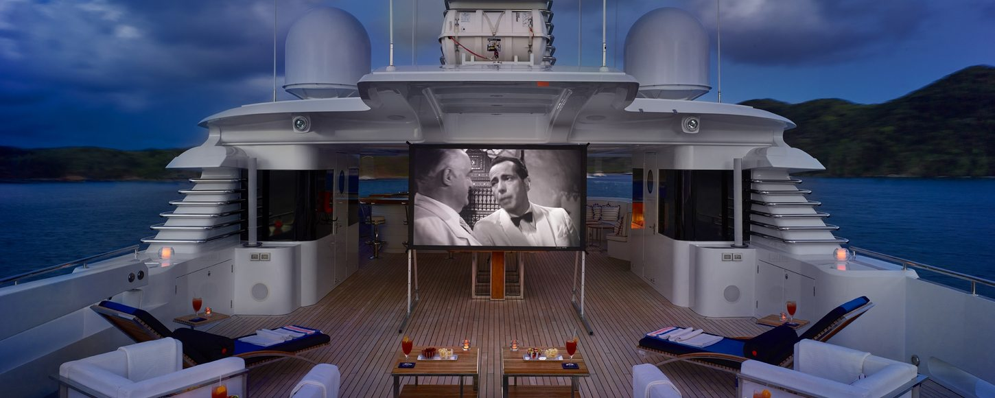 Superyacht Victoria del Mar sundeck transformed into outdoor cinema at night