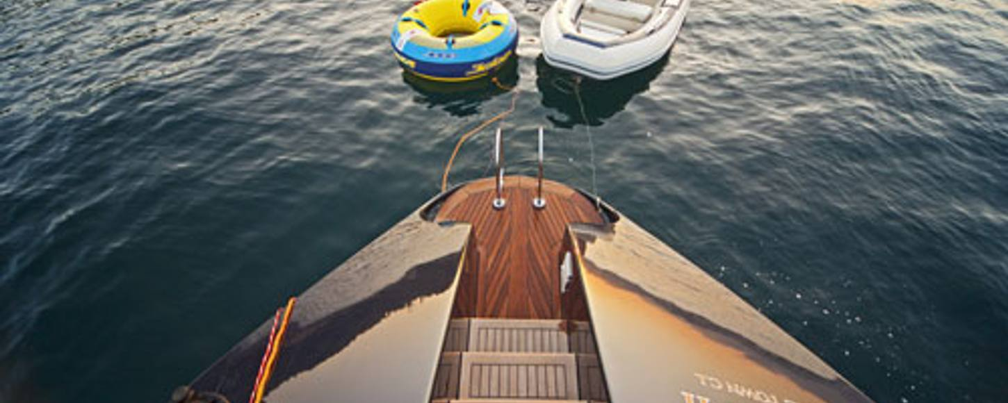 'PK Boo II'  transom with charter toys in water