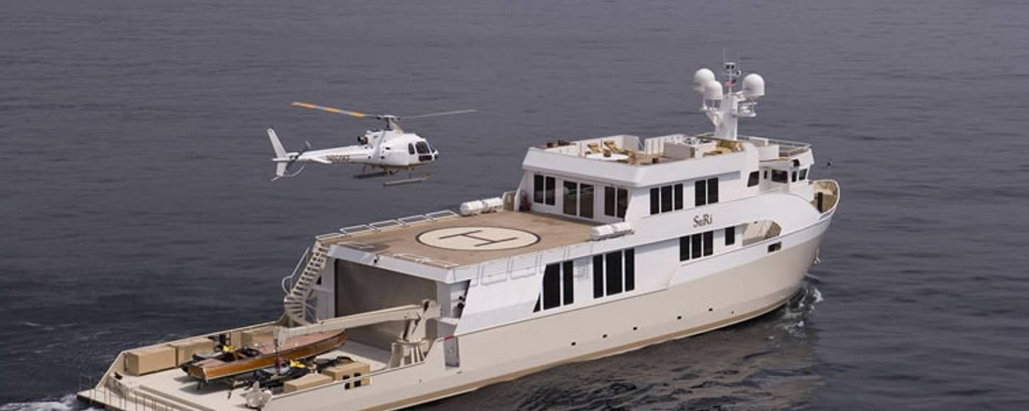 Helicopter landing on charter expedition yacht Suri