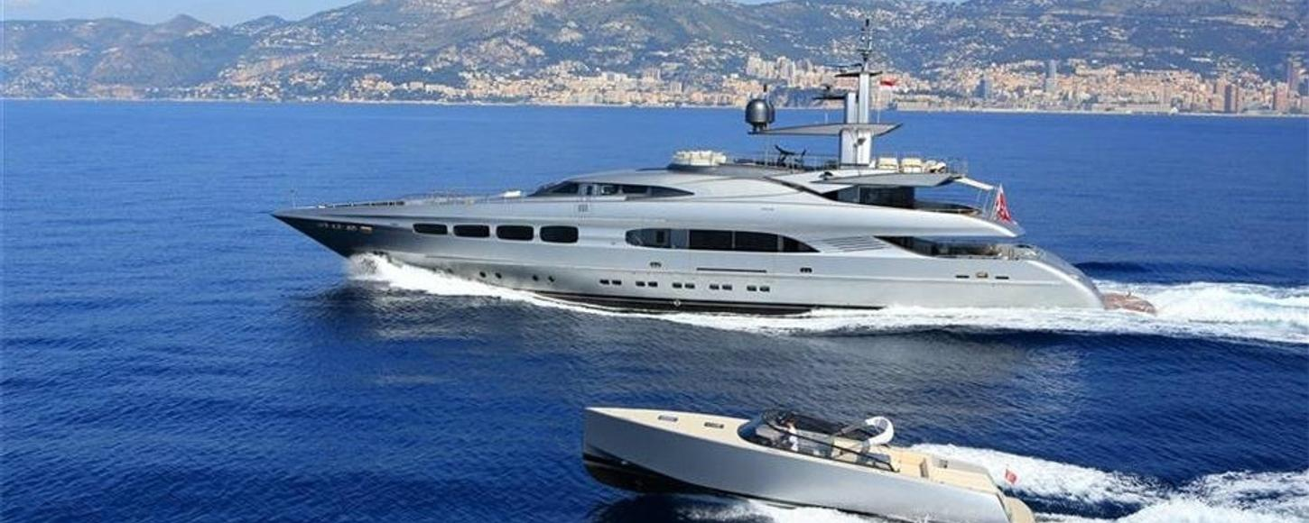 Luxury charter yacht AUSPICIOUS with her tender
