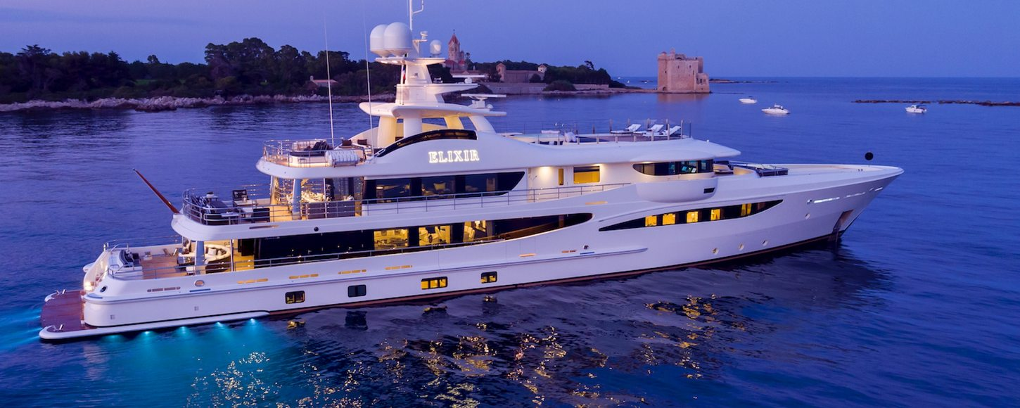 superyacht elixir at night, with underwater lights