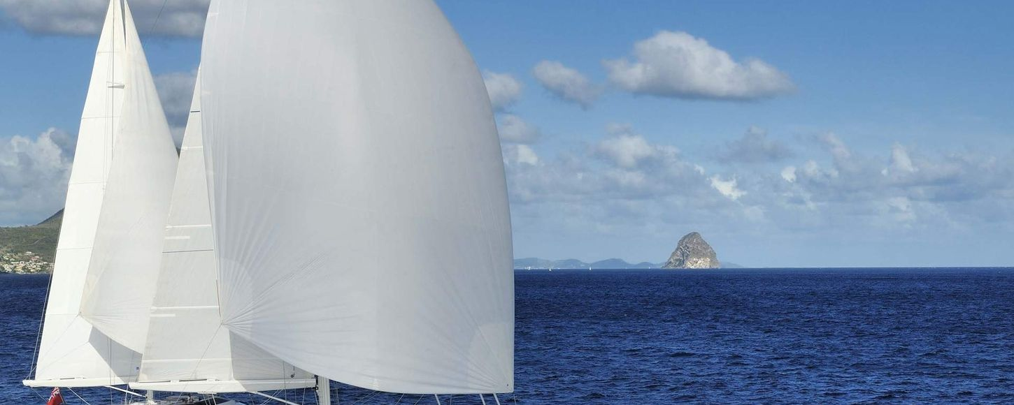 Charter yacht Drumbeat under sail in the Pacific