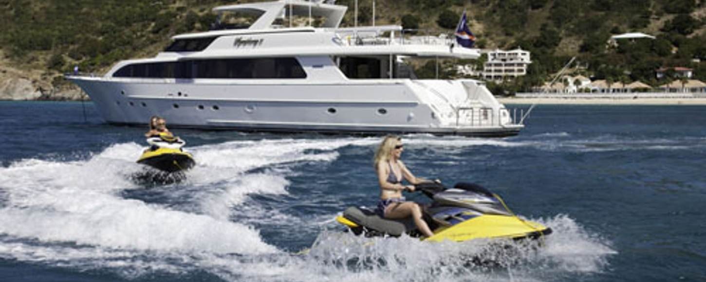 Guests enjoying time on the jet skis around charter yacht 'Symphony II'