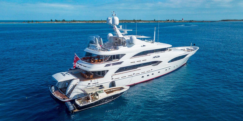 motor yacht AVALON anchored on a luxury yacht charter alongside tender