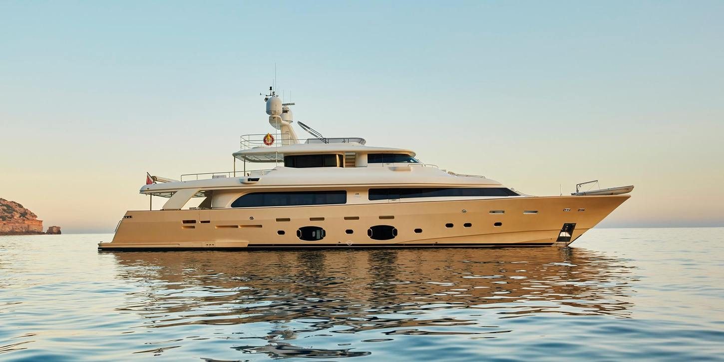 superyacht DEVA anchors on a luxury yacht charter in Ibiza