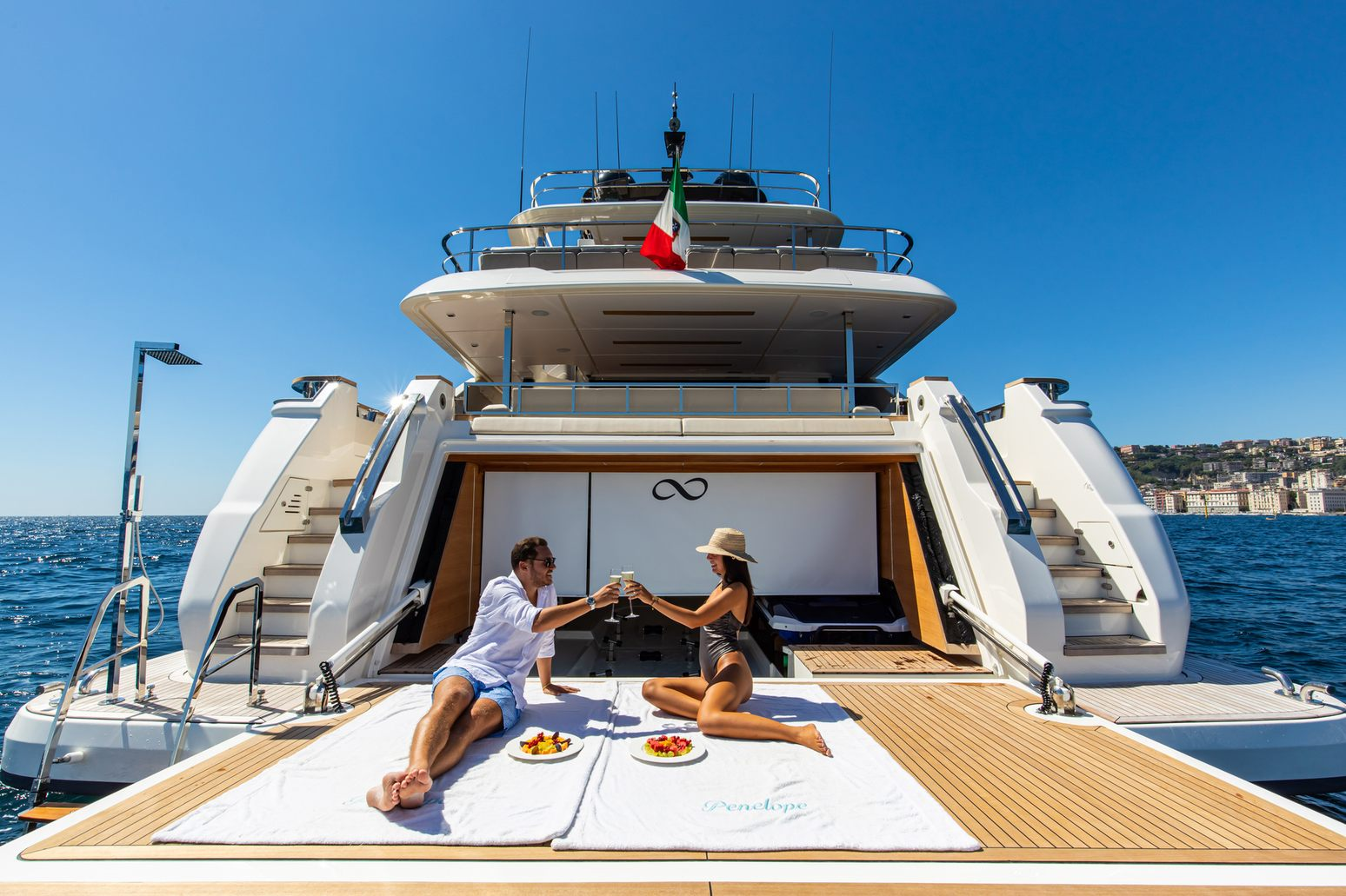 charter guests on the swim platform of luxury yacht penelope