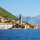 Enjoy views from the sundeck of your charter yacht of the idyllic Adriatic coastline of Montenegro's Perast City, its clusters of red-roofed buildings winding into the hillsides, punctuated only by church steeples and forests.