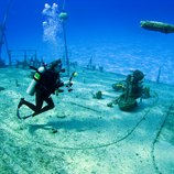 Underwater Photographer shooting the shipwreck Tibbits in Cayman Brac